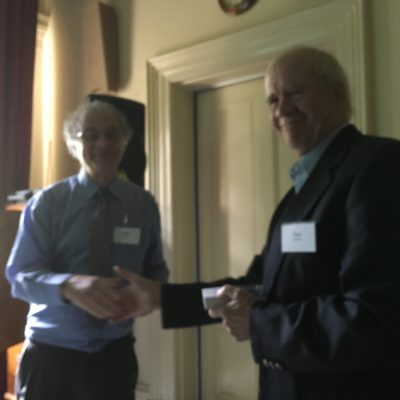 NAA President Walter Bloom presents Paul Holland with his speaker's medallion